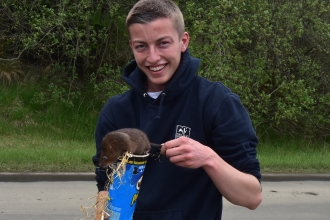 Joel Ireland and a water vole